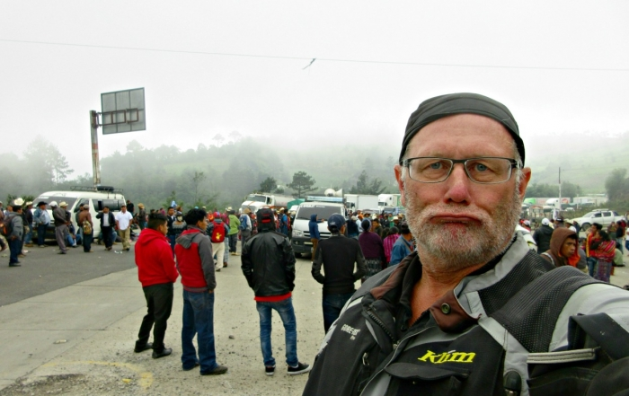 Brian Thiessen, Iron Roamer, standing outside of a protest blocking the road to Antigua.