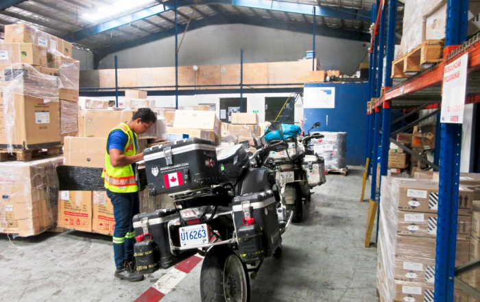 Iron Roamer's, Brian Thiessen's, BMW 1200 GS in the Girag Air Cargo warehouse ready to be flown to Bogota Colombia.