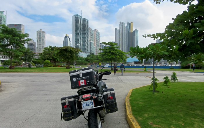 Iron Roamer's BMW 1200 GS at the forefront of the Panama City skyline.
